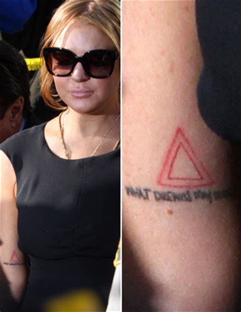 lindsay lohan tattoos lindsay lohan s triangles what it means extratv