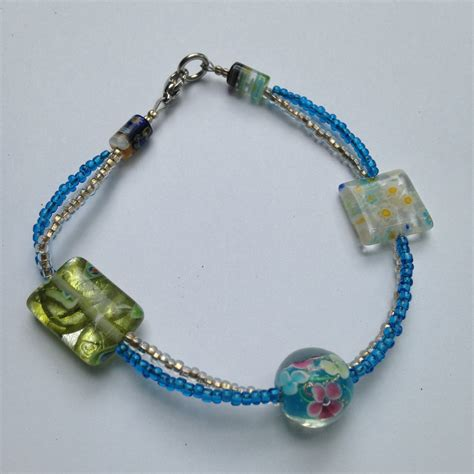 glass bead bracelet clear and blue seed with glass millefiori bead