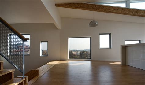 house design image inside zigzag house with panoramic views and a slide inside