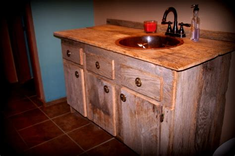bathroom vanity made from barn siding salvaged from