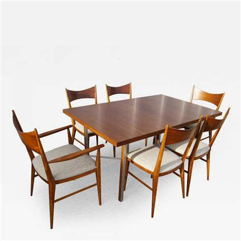 paul mccobb irwin walnut dining table and six