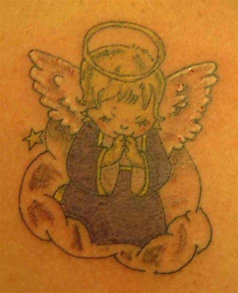 tattoo cartoon angel cartoon angel tattoos tattoo art gallery