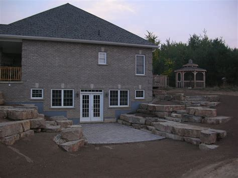 walk out basement walkout basement with limestone tiered retaining walls