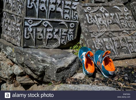 run shoes nepal stones and running shoes nepal stock photo