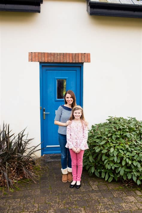 mother daughter house mother and daughter standing near house photo free download