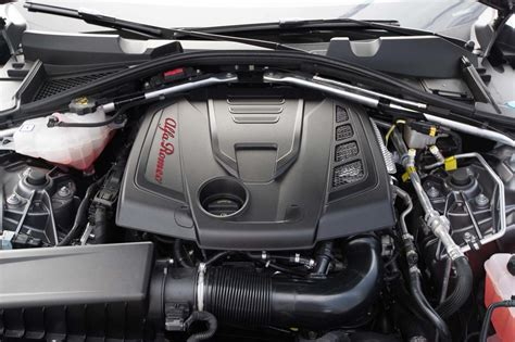 alfa romeo giulia engine alfa romeo giulia contro audi a4 2 0t mercedes c300 lexus is 200t fs cadillac ats jaguar xe