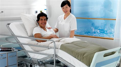 patient in hospital bed safe easy to use hospital bed ensuring quality of care