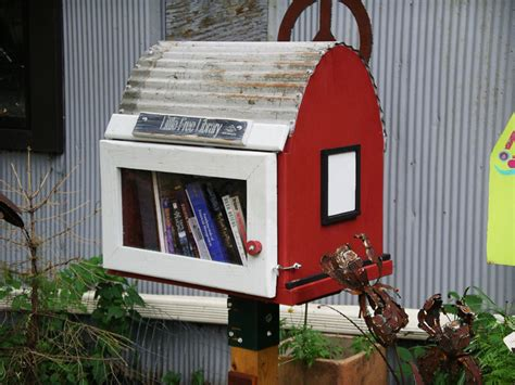tiny library little free library tiny house shaped boxes let you take