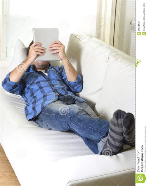 A Relaxed relaxed using digital tablet stock photo