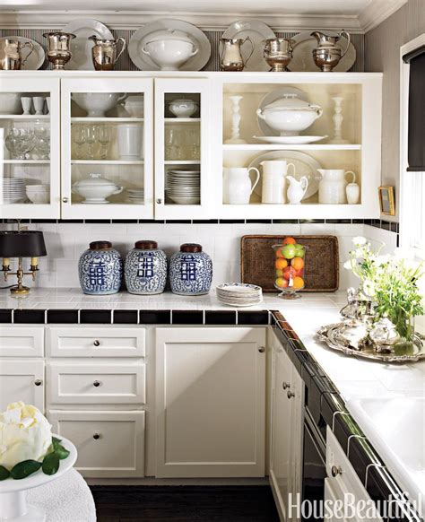 decor for above kitchen cabinets the tricks you need to know for decorating above cabinets