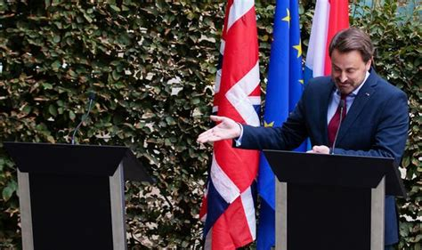 nato summit boris johnson shares arm wrestling handshake  luxembourgs bettel uk news
