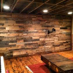 Recycled pallet and reclaimed wood paneling rustic wall panels