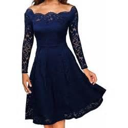 granatowa rozkloszowana koronkowa sukienka midi retro