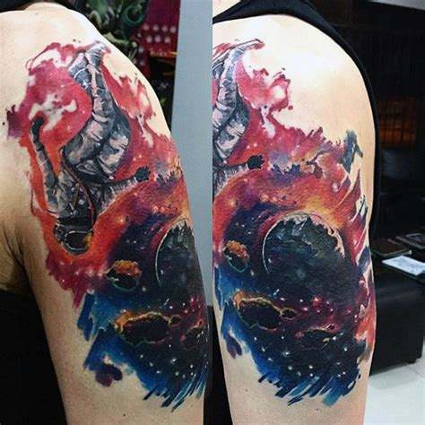 space themed tattoo simple space themed colored on shoulder