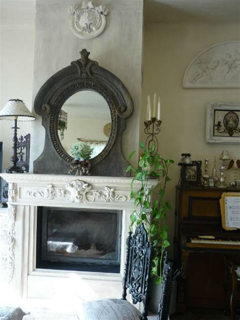 front room mirrors fireplace surrond with mirror country