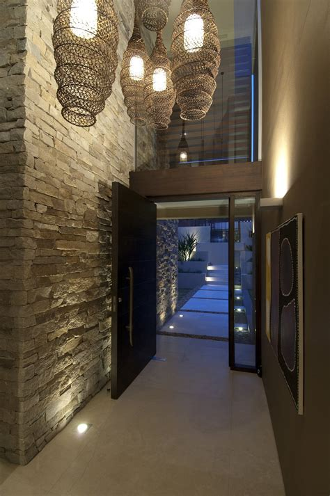 home inside entrance design entrance hall stone wall lighting waterfront home in
