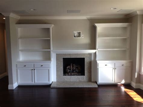 built in shelves around fireplace for the home