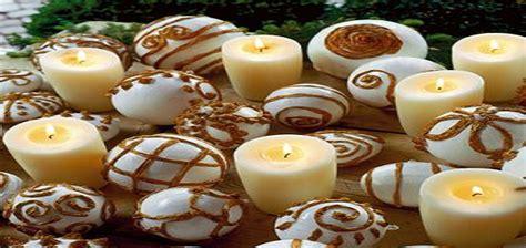decorare le candele per natale come addobbare casa con le candele atmosfera magica