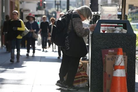 where do homeless people go to the bathroom homeless dragged down by belongings as cities view