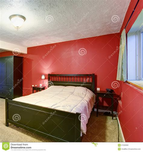 black and red bedroom walls bedroom with red walls black color furniture and beige blanket stock photo image