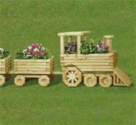 Landscape Timbers Tractor Landscape Timber Tractor With Flowers Planters