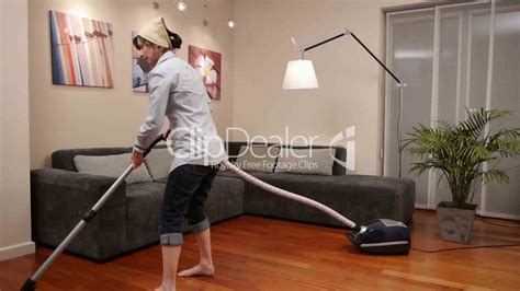 vacuum the living room in cleaning living room vacuum cleaner royalty free and stock footage