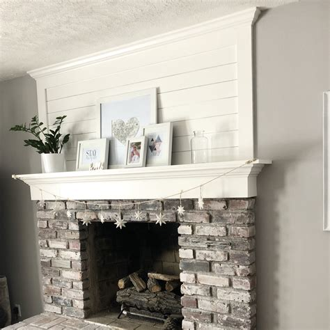shiplap over brick brick fireplace makeover with shiplap and whitewash