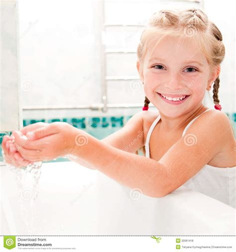 cute girls in bathroom girl washing in bath royalty free stock photos image