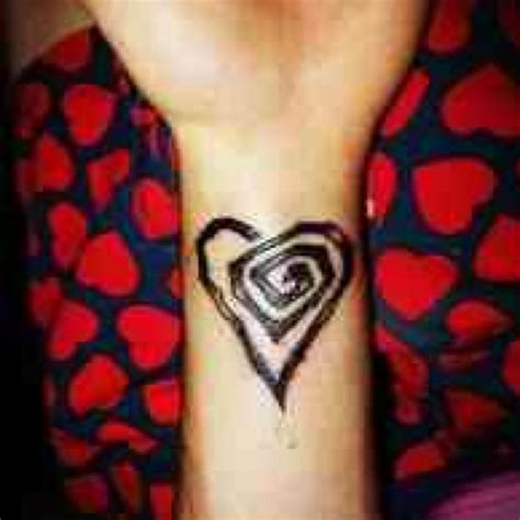 twisted heart tattoo twisted wrist ideas