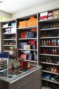 fantastic walk in closet design with gray cabinets filled