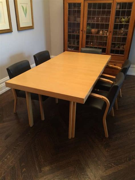 alvar aalto dining table and six armchairs produced by
