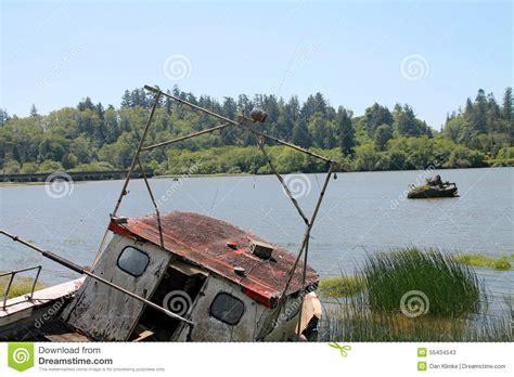 used boats oregon coast fishing boat abandoned on shore in reedsport oregon stock