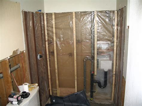 vapor barrier for bathroom walls vapor barrier the vapor barrier installed behind the showe flickr photo sharing