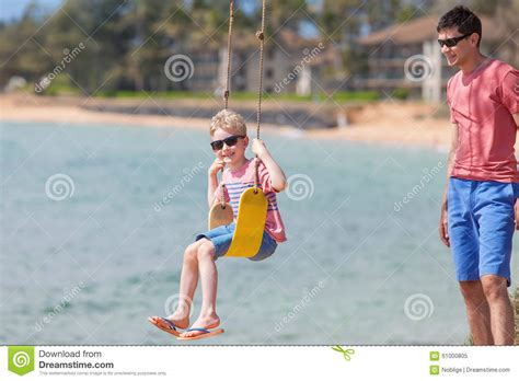 swinging vacations family on vacation stock photo image 61000805
