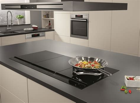 induction hob using a wok serve the stir fry for guests with aeg s induction hob and wok appliances electrolux