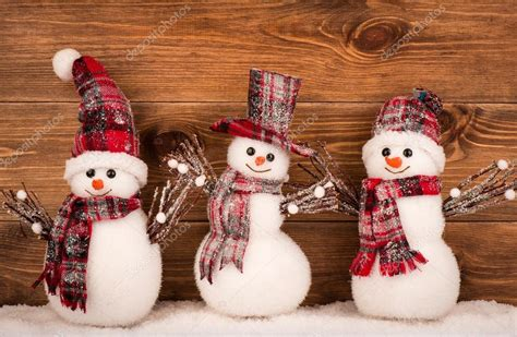 decorative snowman on the brown wooden