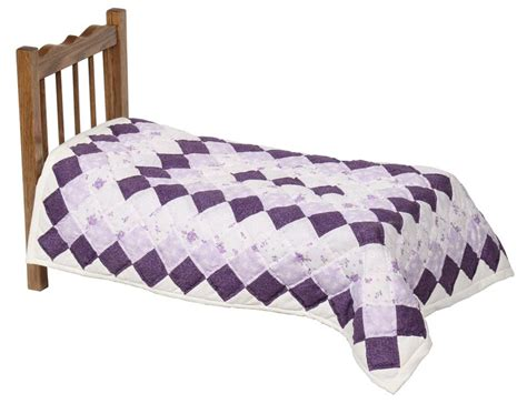 black doll on bed quilt clip images illustrations photos