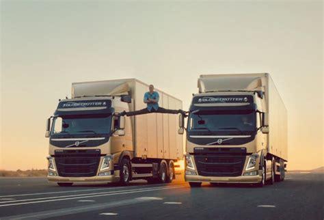 stud jean claude van damme performs famous leg split   reversing volvo trucks