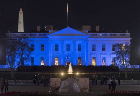 blue and white house white house to be colored blue sunday for autism awareness