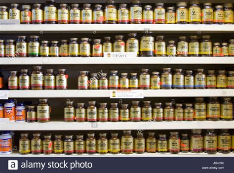 food or supplements rows of vitamin and food supplements in health store