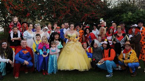 guests join in with fancy dress at disney themed wedding itv news