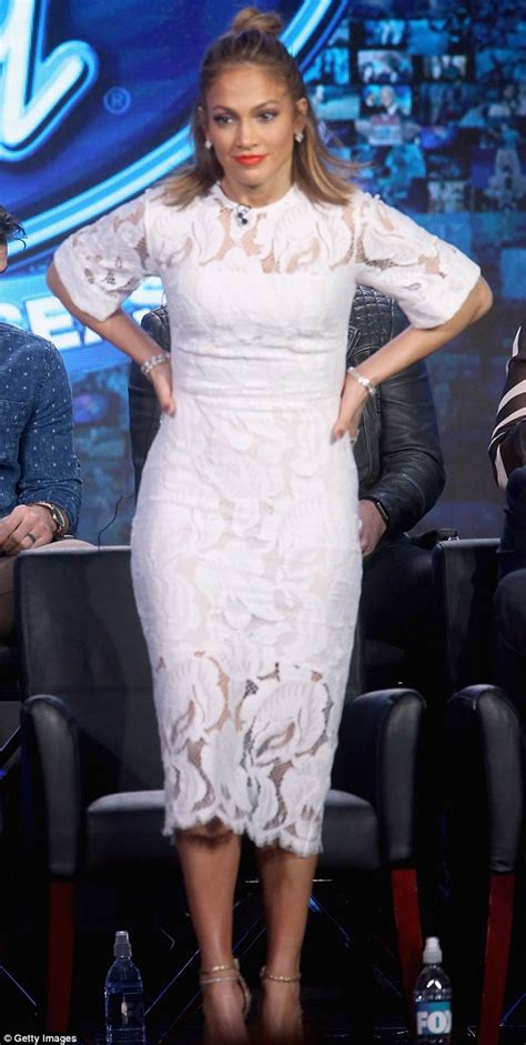 Style J Los Dress by Flashes Legs In Angelic White Dress As She