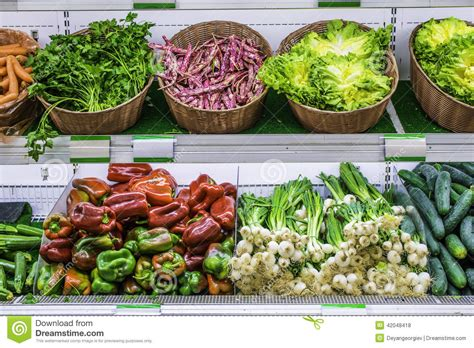 Shelf Vegetable by Fruits And Vegetables On A Supermarket Shelf Stock Photo
