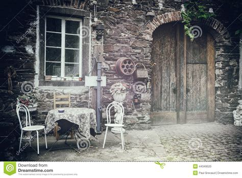 backyard table and chairs old farm backyard with table and chairs stock photo image