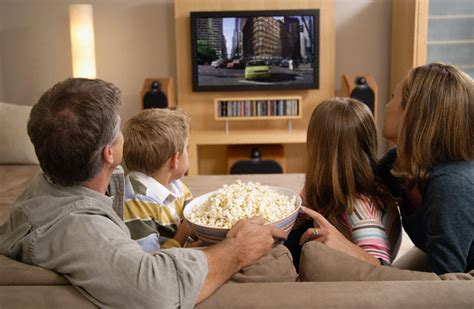 family watching tv with popcorn in living room stock photo ense 241 a a tu hijo a ver la televisi 243 n su hijo