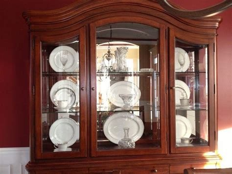 how to organize a china cabinet photos organized china cabinets