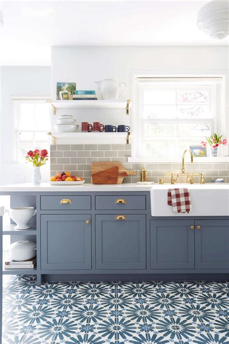 painting kitchen cabinets blue emily henderson blue grey kitchen with concrete tiles in