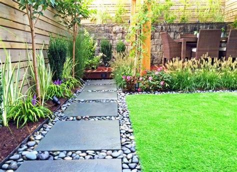 home and garden yard design like the large paver and river rock for off the low deck