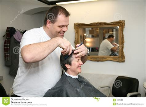 haircuts on women at barbershops a haircut for a lady at the barbers stock photo image