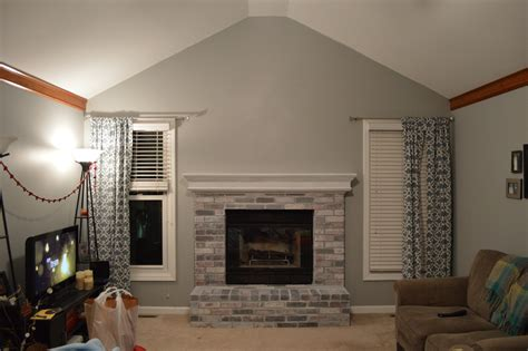 Decor: White Brick Fireplace Makeover With Gray Wall Painting And Single Hung Window Plus
